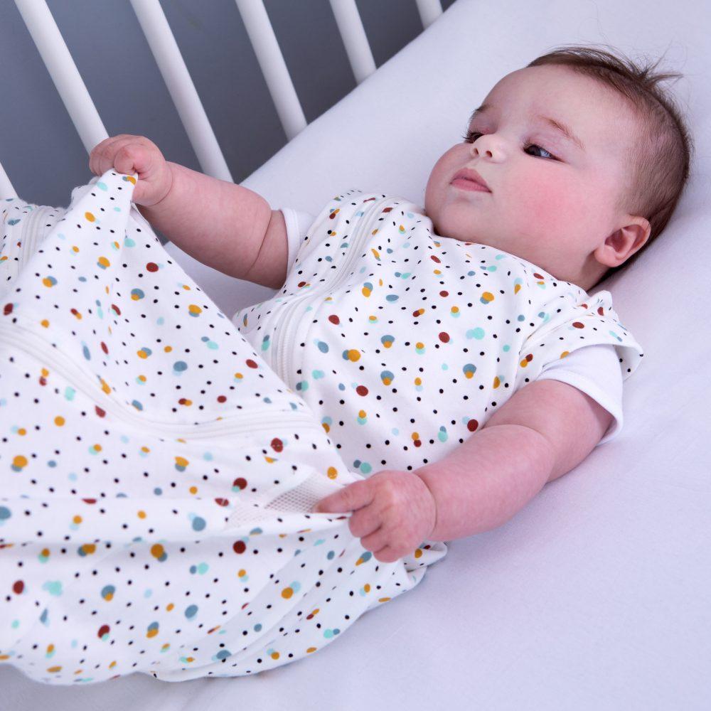Baby happy in scandi spot Purflo baby sleep bag