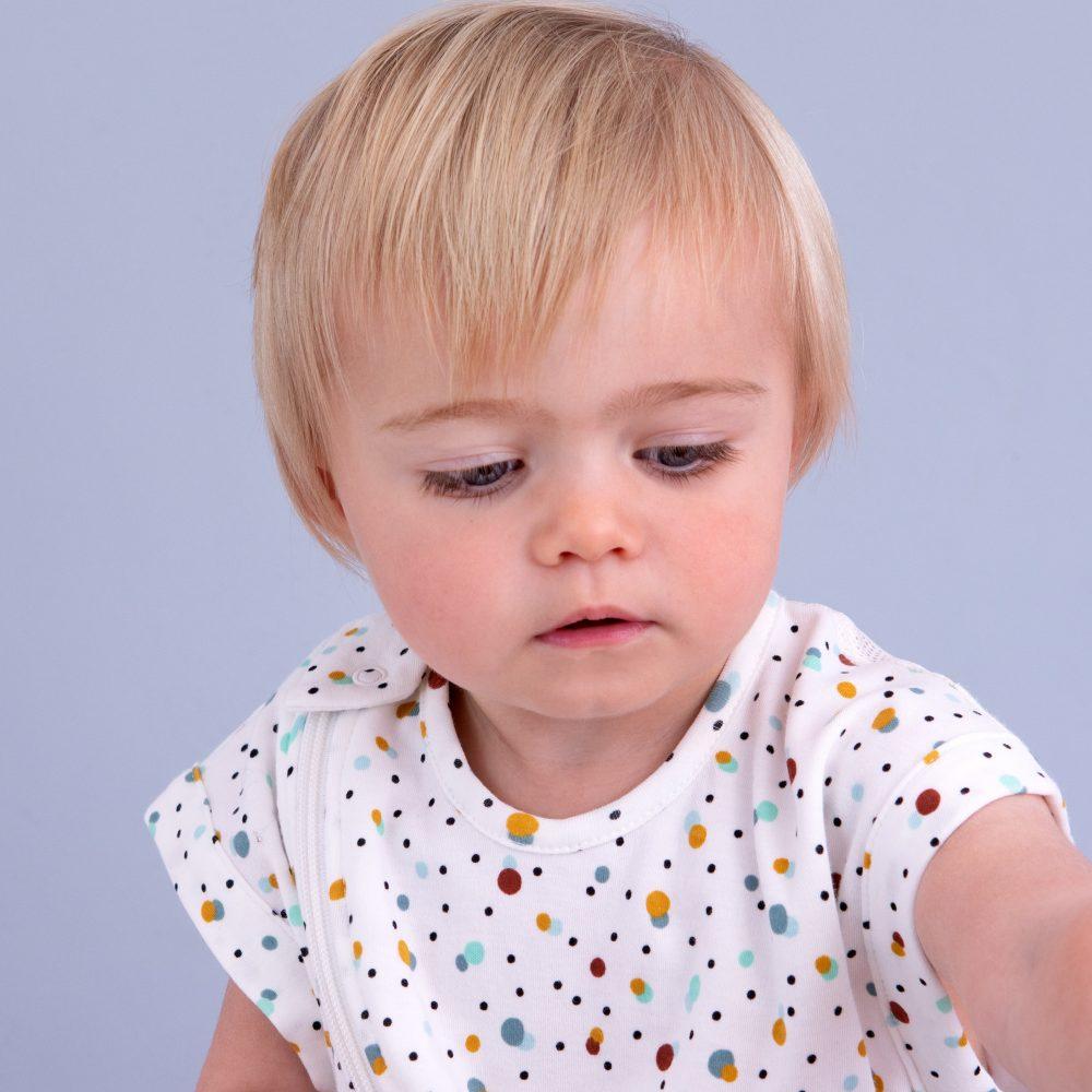 Baby awake in scandi spot Purflo baby sleep bag