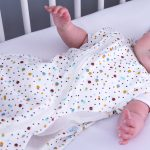 Baby in scandi spot Purflo baby sleep bag in cot